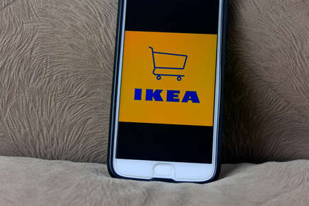 Rio de Janeiro, Brazil - November 25, 2019: IKEA logo on the mobile phone screen. It is a global private company of Swedish origin specializing in the sale of low cost home furniture.