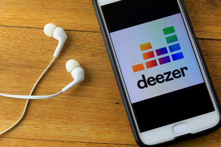 RIO DE JANEIRO, BRAZIL - NOVEMBER 23, 2019: Deezer logo on the mobile phone screen. It is an audio streaming service launched in 2007. Available to users from over 180 countries.