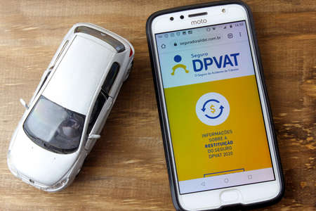 Rio de Janeiro, Brazil - February 9, 2020: DPVAT logo on the Smartphone screen. It is mandatory insurance that indemnifies victims of traffic accidents in Brazil. Editorial