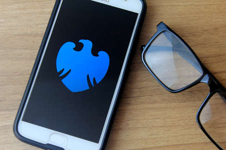 RIO DE JANEIRO, BRAZIL - DECEMBER 22, 2019: Barclays Bank logo on the mobile screen. It is a multinational British bank based in London.