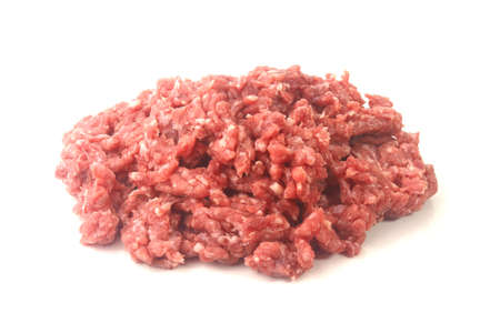 raw minced meat isolated over white background. Top view