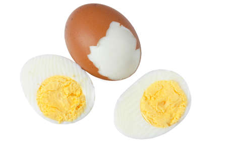 sliced boiled eggs isolated on white background. protein-rich food consumed in ketogenic and low carb diets