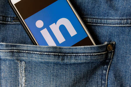 Rio de Janeiro, Brazil - February 14, 2020: Linkedin logo on the smartphone screen, in the pocket of jeans. is a business social network