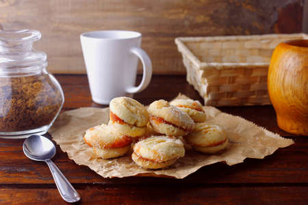 buttered cookies joined by a guava jelly, traditional in Brazil where they are known as goiabinha, on a rustic wooden table