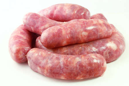 pile of fresh raw pork meat sausage isolated on white background. Top view