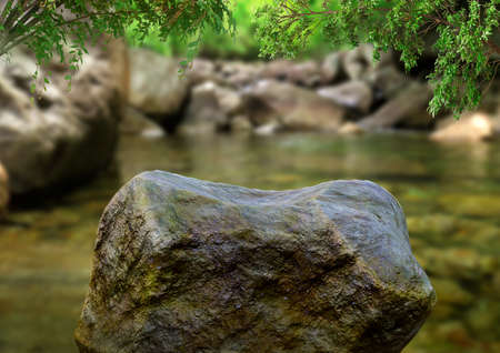 empty stone for product display in nature with waterfall. Free space for product announcements. Selective focus