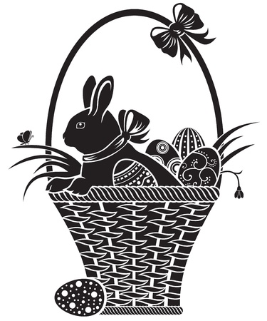 Easter hare sitting in a basket with eggs