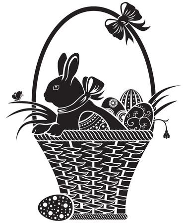 Liebre de chocolate sentado en una cesta con huevos