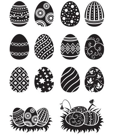 Un ensemble d'oeufs de Pâques en noir et blanc décoré d'ornements