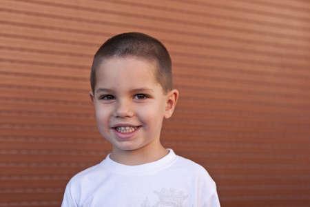 Closeup portrait of happy little boy smiling Stock Photo