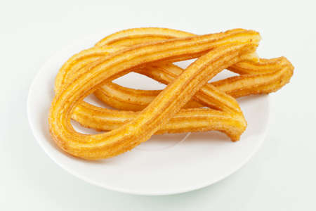 Typical spanish fried pastry in a dessert dish. photo