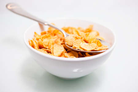 atilde: cereal flakes a bowl with a spoon  Stock Photo