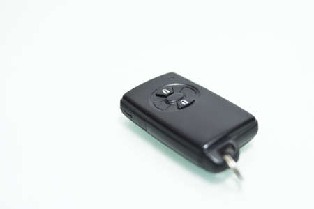 atilde: Car key with integrated remote, isolated on white.