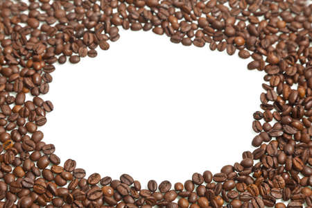 Roasted coffee beans against a white background with copyspace Stock Photo