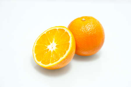 Two perfectly fresh valencian oranges isolated on white  Stock Photo