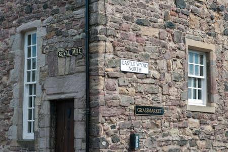 Historic Royal Mile in Edinburgh Scotland. Sign and architecture.
