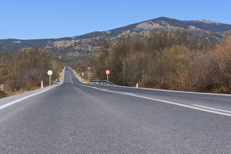 A rural spanish road on the way to Navacerrada, Madrid photo