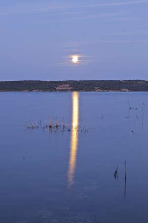 Moon reflection at Pedrezuela reservoir  Guadalix de la Sierra, Madrid  Spain