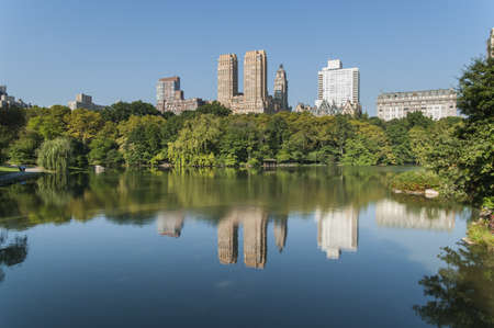 New York City Manhattan Central Park panorama lake with skyscrapers and colorful trees with reflection