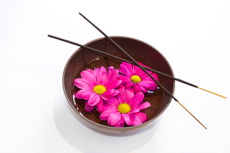 rin gong: Tibetan bowl with oil massage with flowers and incense sticks  Stock Photo
