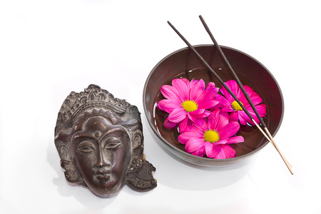 rin gong: Image of a Tibetan bowl with flowers and incense and a head of budha Stock Photo
