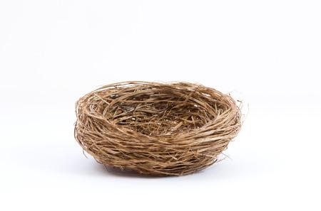 Studio shot of an empty bird nest isolated on white background Foto de archivo