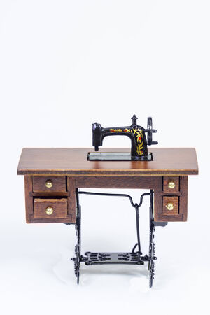 Studio shot of a vintage sewing machine isolated on white photo