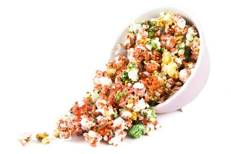 spilling: Spilling colorful sweet popcorn isolated on white background