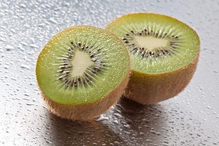 Sliced Kiwi fruit. Two halfs.