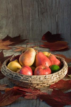 Seasonal fruits in a basket.