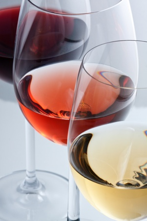 Glasses with white, rose and red wine.