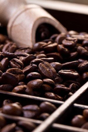 Coffee beans in a wooden drawer.
