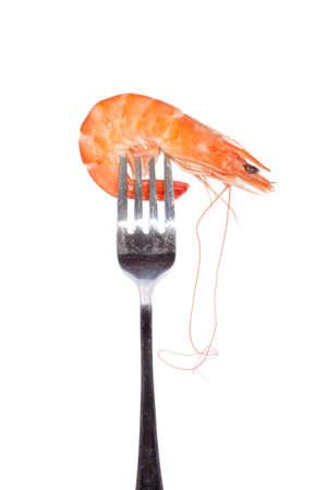 raw gold: Shrimp on fork, photo on the white background