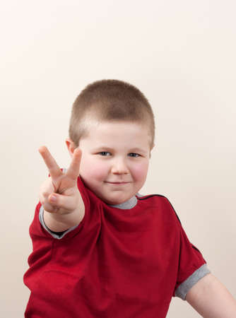 portrait of little boy in red shirt photo