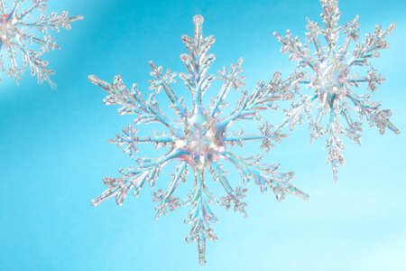 Snowflake shape, photo on the blue background photo