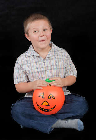 boy with the pumpkin - on black photo
