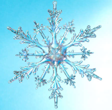 Snowflake shape, photo on the blue background