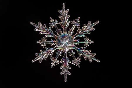 Snowflake shape, photo on the black background