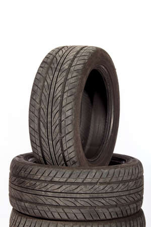 Used, dirty tires isolated on white photo