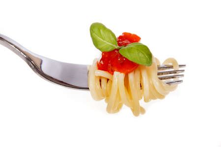Spaghetti with sauce isolated on white