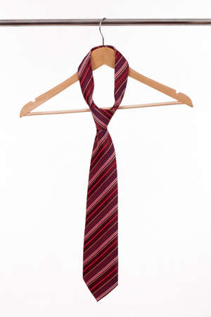 clotheshanger: Hanger for clothes with tie isolated on white