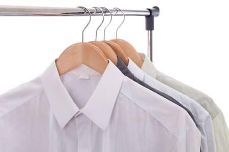 Clothes hanger with shirts isolated on white