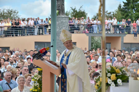 apostolic: Aljmas, Croatia.August 15, 2014. The Catholic holiday of the Assumption of Mary in Shrine of Our Lady of shelter. Tens of thousands pilgrims visited shrine every year.The grand celebration of Mass at 10:00 led by the Bishop of Mostar-Duvno and Apostolic A