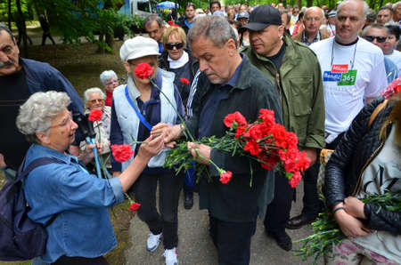01: Zagreb, Croatia. 01 May 2015. On the occasion of Labor Day Milan Bandic shared carnations and beans to citizens in Maksimir Park
