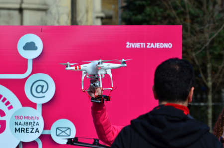 fastest: Zagreb,Croatia. 21. Feb 2015. Croatian Telecom demonstrated the fastest internet on the Petar Preradovic square. With drones they promote fast 4G network with live stream on big LCD screen.