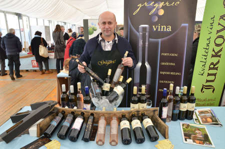 gathered: Zagreb,Croatia. 15th February, 2014.. Croatian wine story - festival of love and wine at Ban Jelacic Square has gathered a large number of domestic wine producers