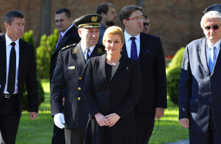 wreaths: Zagreb,Croatia. 25th June 2015. Laying of wreaths at the City Cemetery Mirogoj on the occasion of Statehood Day. Croatian President Kolinda Grabar Kitarovic, Croatian Parliament president Josip Leko and Mayor Milan Bandic laid wreaths and candles at The m Editorial