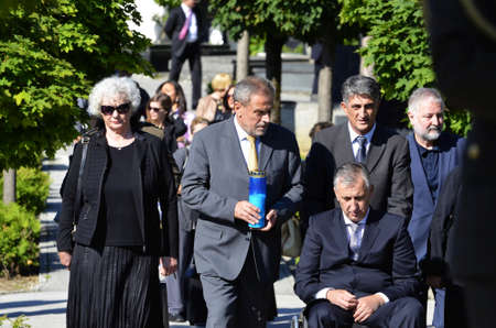 national military cemetery: Zagreb,Croatia. 25th June 2015. Laying of wreaths at the City Cemetery Mirogoj on the occasion of Statehood Day. Croatian President Kolinda Grabar Kitarovic, Croatian Parliament president Josip Leko and Mayor Milan Bandic laid wreaths and candles at The m Editorial