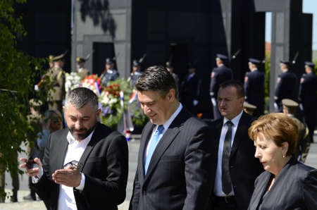 national military cemetery: Zagreb,Croatia. 25th June 2015. Laying of wreaths at the City Cemetery Mirogoj on the occasion of Statehood Day. Prime minister Zoran Milanovic laid wreaths and candles at The monument Voice of Croatian Victims - Wall of Pain, at the tomb of Franjo Tudjma