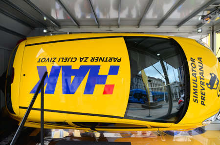 rollover: Zagreb, Croatia. 17th May 2014. HAK-Croatian Auto Club had an educational program where citizens could get information about traffic safety. Citizens were able to sit in a simulator for the safety of the roll-over car. Editorial